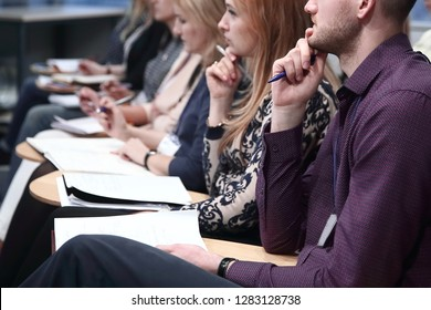 Concentrated young business people listening report about company