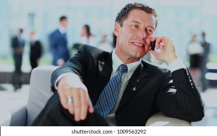 Concentrating businessman on a call.