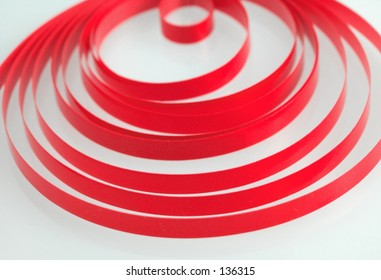concentric circles of red ribbon