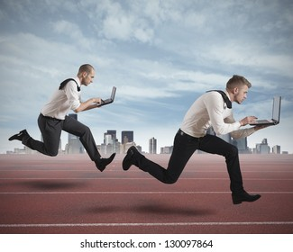 Conceot of competition with two running businessman in a track