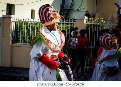 Concepcion De La Vega, DOMINICAN REPUBLIC - FEBRUARY 09, 2020: people in egyptian faraon costumes walk by city street at dominican carnival on February 9 in Concepcion De La Vega