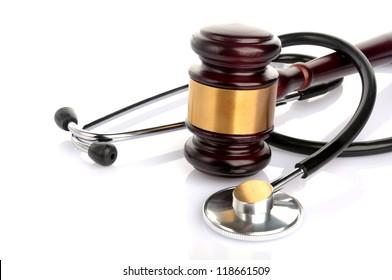concept about medical lawsuit, stethoscope and gavel on white background