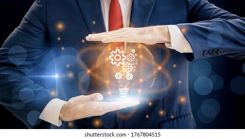 Concept of achievement,new ideas and innovation,creative and inspiration,with business and industry in future,businessman holding light bulb icon,and infinity power of energy,in development human