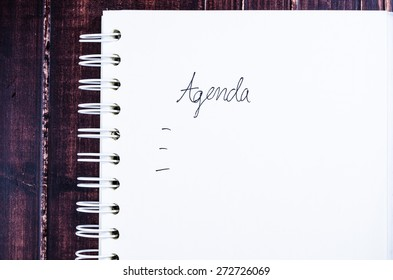 Concept of agenda record,notebook on wooden background