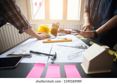 Concept Agreement between the employer and architect Nick and desk of Architectural project in construction site or office building