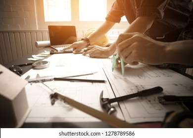 Concept Agreement between the employer and architect Nick and desk of Architectural project in construction site or office building with mining light
