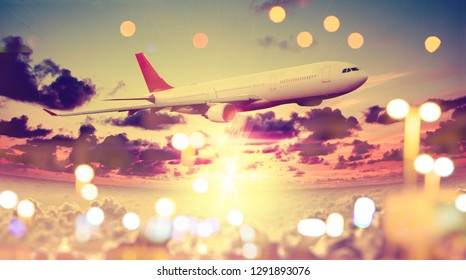 Concept of airplane travel. Flying above the city. Scenery sunset landscape.Sunrise and clouds. Flight and journey to destination