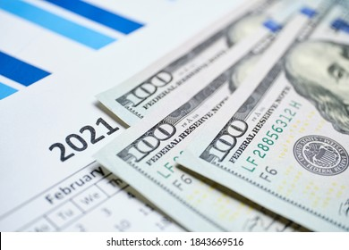 Concept of the American dollar in 2021 on the calendar.
