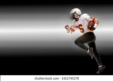 Concept american football, american football player with ball in hand. Black white background, copy space. American football sportsman player in action