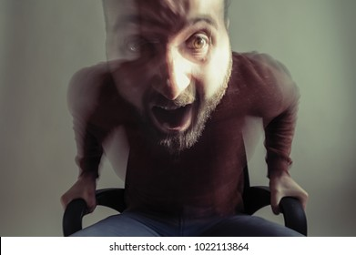 Concept of anger. Dynamic portrait of an angry man. To create the expression, the effect of dynamic blurring is applied.
