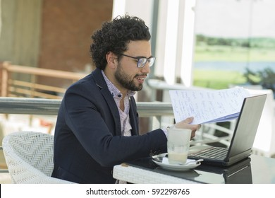 concept of Arabian Arabic Egyptian young elegant business attractive man model having a coffee break in Cairo Egypt at middle east, africa