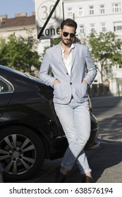Concept of Arabic smart elegant attractive model business man with sunglasses in Europe, Vienna, middle eastern Guy, Arabic guy in public aria.