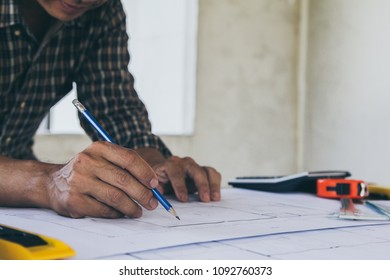 Blueprint paper images stock photos vectors shutterstock concept architectsengineer holding pen pointing equipment architects on the desk with a blueprint in malvernweather Image collections