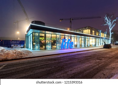 Concept for Architectural sales office. Exterior and facade of a sales office for a urban residential construction project. Evening view. Moscow - 2018