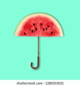 Concept art collage. Watermelon Umbrella on green background.