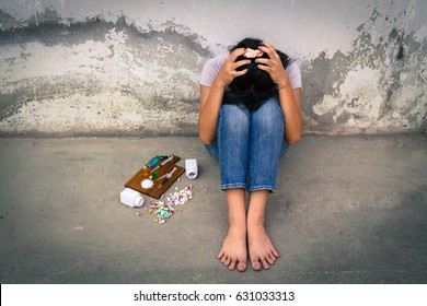 Concept Asia young girl is sad by drug addiction. Drug addiction in adolescence.
