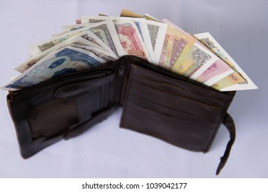 Concept of Asian business. Leather trophy wallet with Vietnamese currency dong. Wallet with money inside. Money counting.   Denominations of Vietnam in purse.