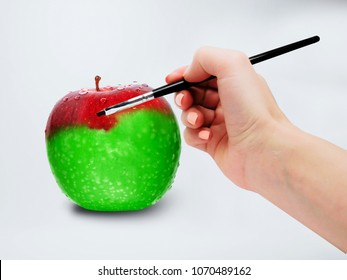 Concept of assimilation by painting green apple into red color