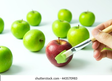 Concept of assimilation by painting red apple into green color