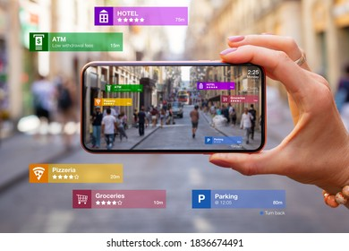 Concept of augmented reality technology being used in mobile phone for navigation and location based services - Shutterstock ID 1836674491