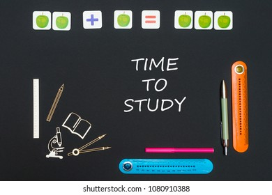 concept back to school, above stationery supplies and text time to study on black backboard
