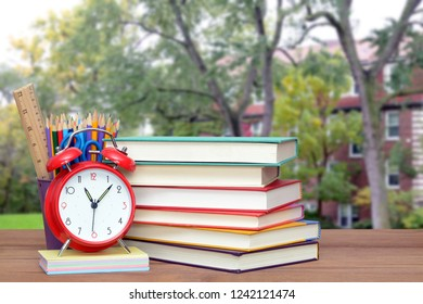 concept of Back to School with empty campus, books, and school supplies