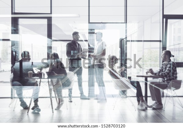 Concept background with business people silhouette working in a modern office. Double exposure