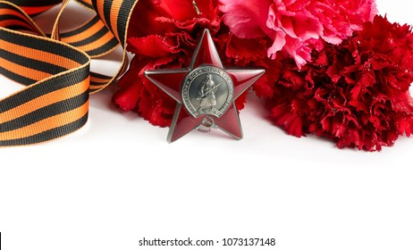 Concept background of May 9 russian holiday Victory Day. Red carnations, St. George's ribbon and order of the Red Star. Isolated on white background, close up, copy space