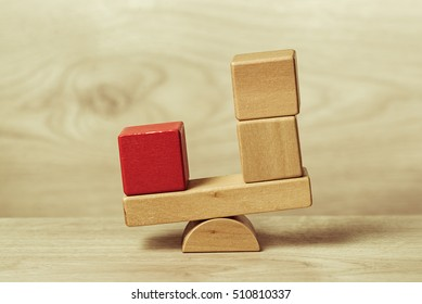 The concept of balance shown wooden toy blocks