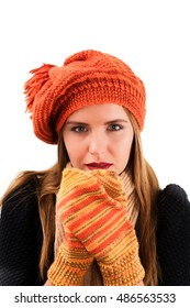 Concept of Beautiful Frozen Girl in Orange Striped Knitted Hat and Mittens, Black Warm Sweater and Scarf isolated on White background