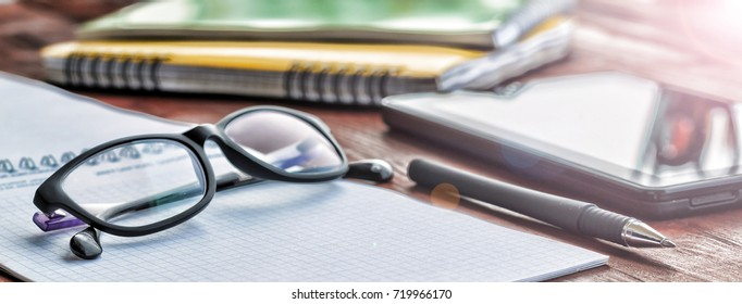 Concept of the beginning of the school year or work desk in the office In the morning sun