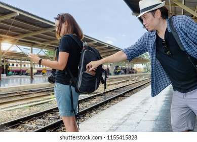 The concept of being careful during travel : Thief was stolen wallet of Asian woman tourists while she was look her map.