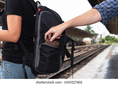 The concept of being careful during travel : Thief was stolen wallet of Asian woman tourists