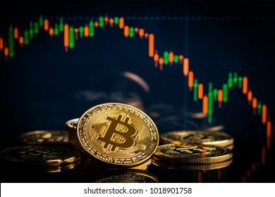 Concept with bitcoins and falling candle graph on background.