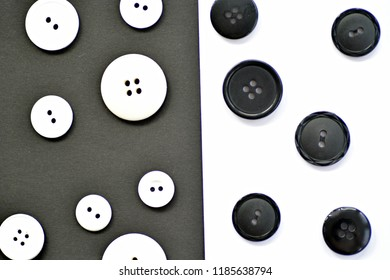 Concept with black buttons on white background and white buttons on black background - contrasts and shadows with buttons in black and white