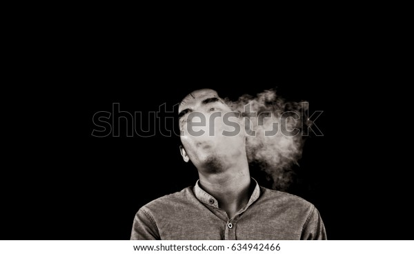 Concept Black and white man smoking on black background