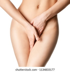 Concept of body care gynecology and woman's health. Close up photo of woman hide with hands Intimate part of her abdomen