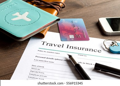 concept booking travel insurance on wooden background