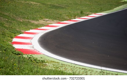 Concept of borderline, boundary, limit. Motorsport racing asphalt track round with red curb detail