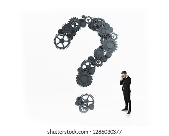 Concept of brainstorming. Man thinking back to question mark from gears