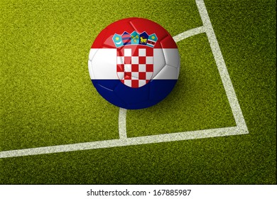Concept for Brazil 2014 football championship. A soccer ball on green field with Croatia flag on it.