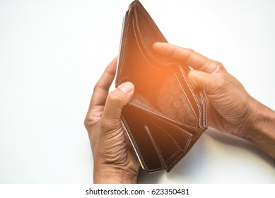 Concept Broke man showing his black wallet with no money on white background