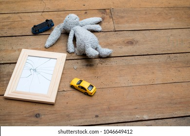 concept of broken marriage. Broken glass picture frame on floor mockup