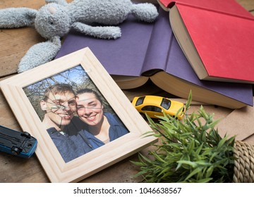 Concept of broken marriage with shattered picture frame on floor