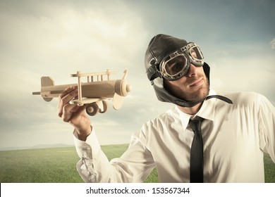 Concept of business in action with businessman with a airplane