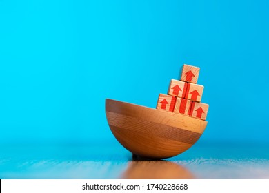 The concept of business improvement, personal development and growth. A pyramid of wooden cubes standing on an uneven base. Blue background. Copy space. The concept of benchmarking