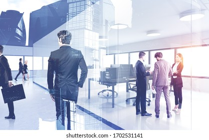 Concept of business meeting. Modern business people working together in spacious office with double exposure of Moscow city panorama. Toned image