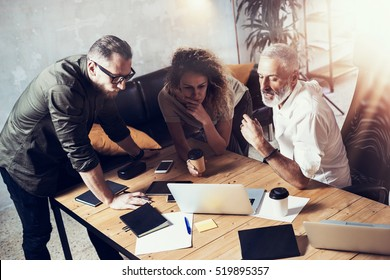 Concept of business people brainstorming.Bearded man talking with account director and creative manager to finding great work solution.Horizontal, blurred background