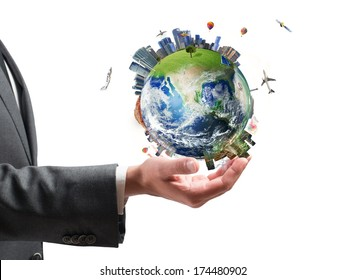 Concept of business power. Businessman holds modern World. Earth provided by NASA
