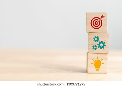 Concept of business strategy and action plan. Wood cube block stacking with icon